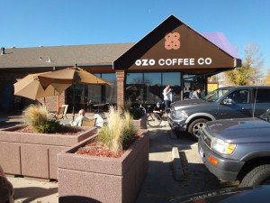 Exterior of Ozo Coffee, crowded with cars