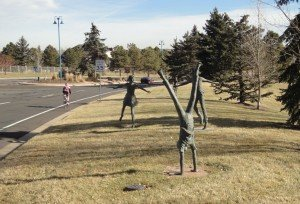 Art; boys and girls doing a handstand, jumping, having fun. This art is at the entry to Rock Creek. It is cast metal, bronze I think