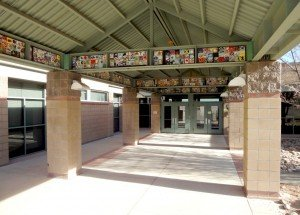 walkway to school; along the ceiling of this enclosure are little tile plates, each hand made by a student making a mosaic