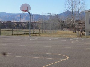 basketball court with the Rocky Mountains in the background, at Superior elementary school