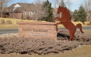 Superior Elementary School sign with a rearing Bronco and in the background a nice house