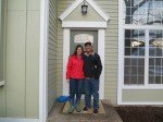 Rebecca and her boyfriend Anthony, on the front steps of her new home