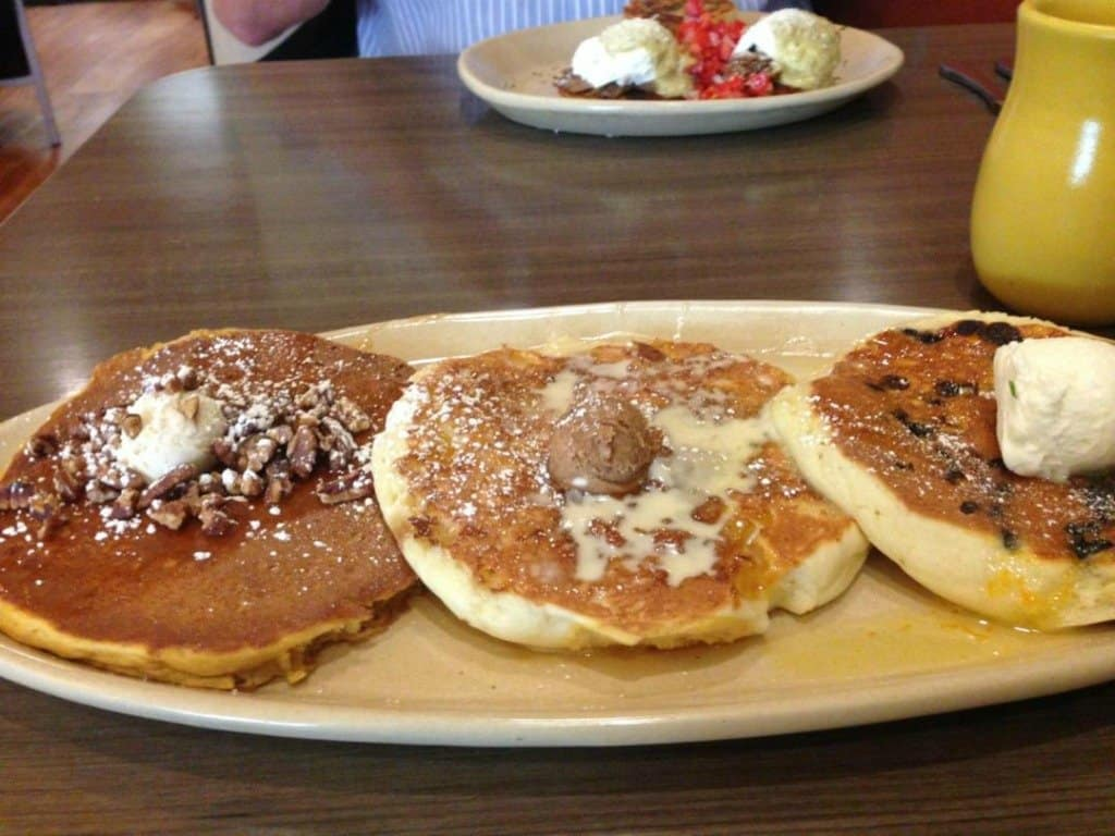 """flight"""" of three pancakes. Snooze breakfast eatery is delicious ..."""