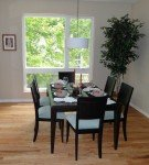 staged dining room table is set for company