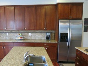 kitchen is staged with very little on counter tops
