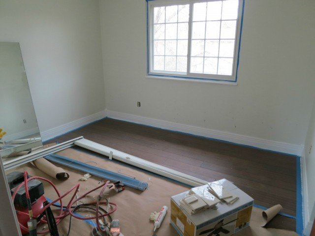 Boulder Colorado Home Remodel adds new wood floors to the bedrooms and replaces the trim with white creating a more open feeling