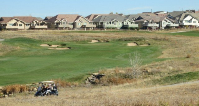 Vista Ridge in background of a hole at colorado national golf course
