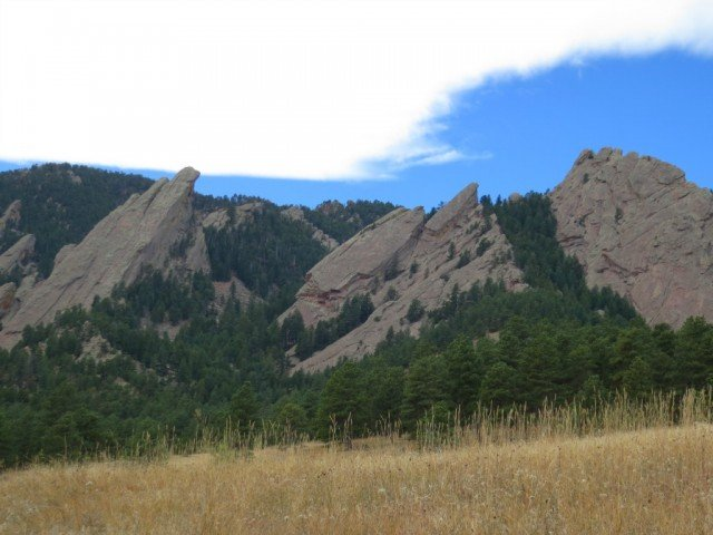 clouds and mountains in boulder colorado at chautauqua