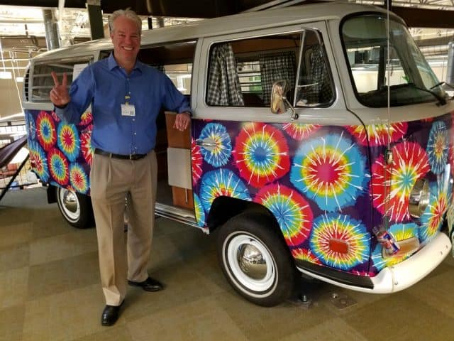 boulder appraisal and real estate expert bob gordon picutred in front of colorful vw at google boulder
