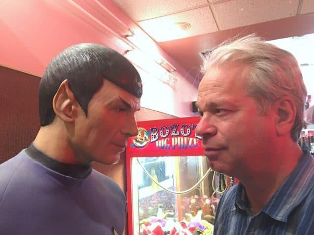 spock statue on left and realtor bob gordon staring eye to eye