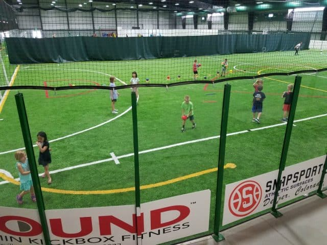 indoor sports stable field with young campers
