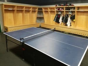 sports stable hockey locker room with ping pong table