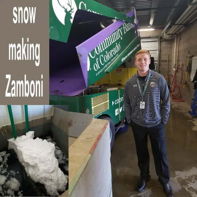 college intern garrett standing beside a zamboni ice maker