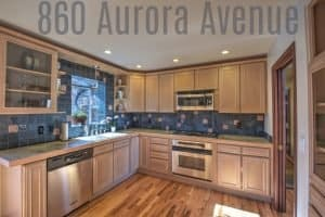 kitchen of house at 860 aurora ave boulder with blue back splash, cabinets stretching to the ceiling and stainless steel appliances