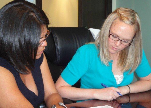 Sara, my coach from boot camp, signing at her closing