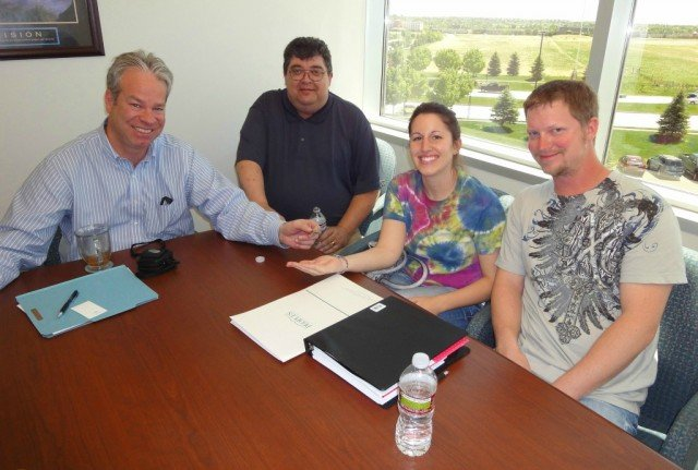 bob gordon and john arnold and beth & frank in a real estate closing