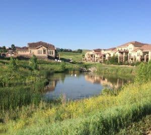 A pond lays between two grandiose homes in Calmante, Superior