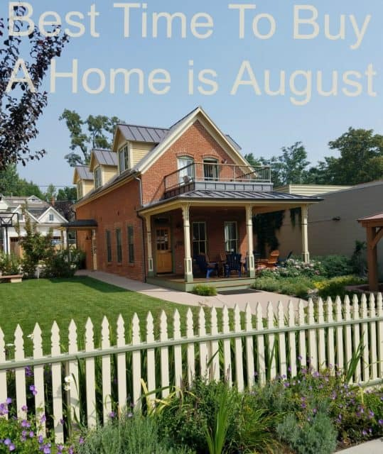 brick boulder house with picket fence and caption on photo reads best time to buy a home is august